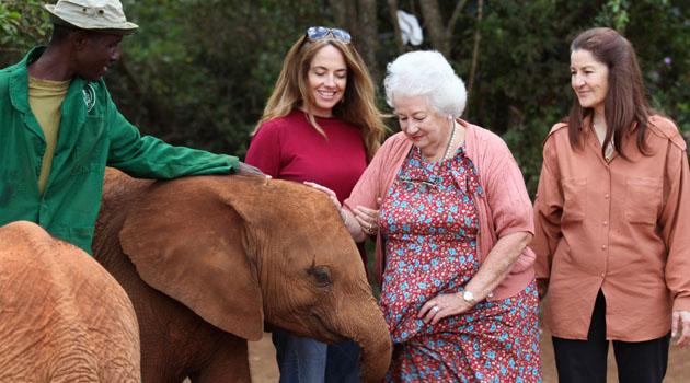 Dame Daphne Sheldrick with orphaned elephant
